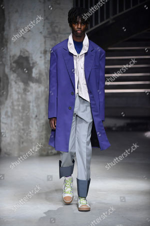 A model presents a creation from the Spring/Summer 2019 Men's Collection by Dutch designer Lucas Ossendrijver for Lanvin during the Paris Fashion Week, in Paris, France, 24 June 2018. The presentation of the Men's collections runs from 19 to 24 June.
