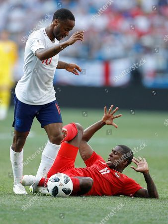Panama's Armando Cooper, bottom, and England's Raheem Sterling stump during the group G match between England and Panama at the 2018 soccer World Cup at the Nizhny Novgorod Stadium in Nizhny Novgorod, Russia