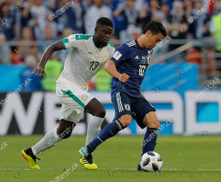 Stock Image of Japan's Shinji Kagawa, right, and Senegal's Alfred Ndiaye challenge for the ball during the group H match between Japan and Senegal at the 2018 soccer World Cup at the Yekaterinburg Arena in Yekaterinburg, Russia