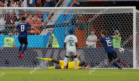 Senegal goalkeeper Khadim Ndiaye is beaten by the equalizing goal of Japan's Takashi Inui (not in the picture)during the group H match between Japan and Senegal at the 2018 soccer World Cup at the Yekaterinburg Arena in Yekaterinburg, Russia