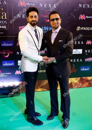 Stock Picture of Ayushmann Khurrana, Gulshan Grover. Bollywood actors Ayushmann Khurrana, left, and Gulshan Grover pose on the green carpet at 19th edition of International Indian Film Academy (IIFA) awards in Bangkok, Thailand