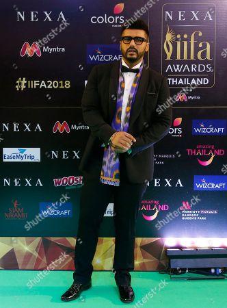 Bollywood actor Arjun Kapoor poses on the green carpet at 19th edition of International Indian Film Academy (IIFA) awards in Bangkok, Thailand