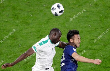 Stock Picture of Senegal's Cheikh Ndoye, left, and Japan's Maya Yoshida jump for the ball during the group H match between Japan and Senegal at the 2018 soccer World Cup at the Yekaterinburg Arena in Yekaterinburg, Russia