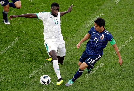 Stock Picture of Senegal's Alfred Ndiaye, left, and Japan's Makoto Hasebe vie for the ball during the group H match between Japan and Senegal at the 2018 soccer World Cup at the Yekaterinburg Arena in Yekaterinburg, Russia