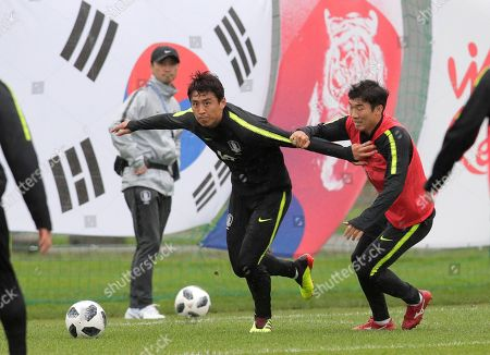 South Korea's Koo Ja-cheol, left, and Go Yo-han attend South Korea's official training in Lomonosov near St. Petersburg, Russia, at the 2018 soccer World Cup