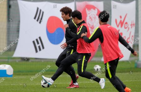 Korea's Oh Ban-suk, left, and Jung Seung-hyun, centre, attend South Korea's official training in Lomonosov near St. Petersburg, Russia, at the 2018 soccer World Cup