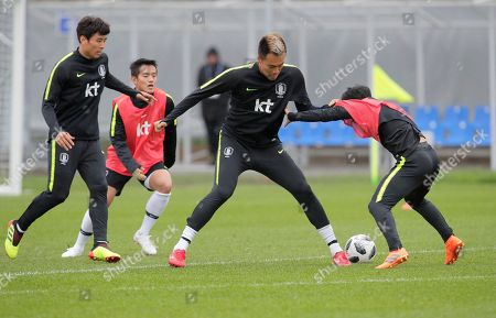 South Korea's Kim Shin-wook, centre, and his teammate attend South Korea's official training in Lomonosov near St. Petersburg, Russia, at the 2018 soccer World Cup