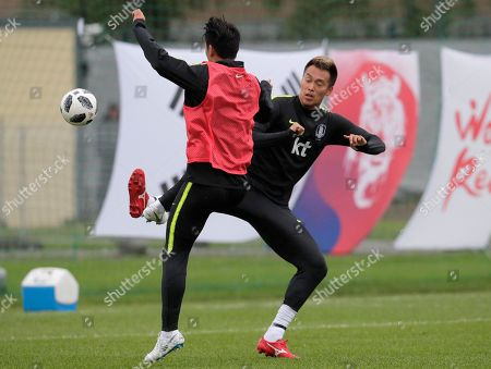South Korea's Kim Shin-wook, right, and his teammate attend South Korea's official training in Lomonosov near St. Petersburg, Russia, at the 2018 soccer World Cup