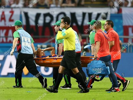 Abel Aguilar of Colombia leaves the game through injury on a stretcher