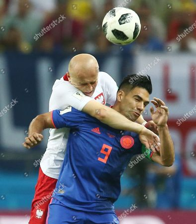 Michal Pazdan of Poland and Radamel Falcao Garcia of Colombia