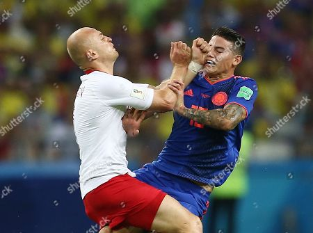 Michal Pazdan of Poland and James Rodriguez of Colombia