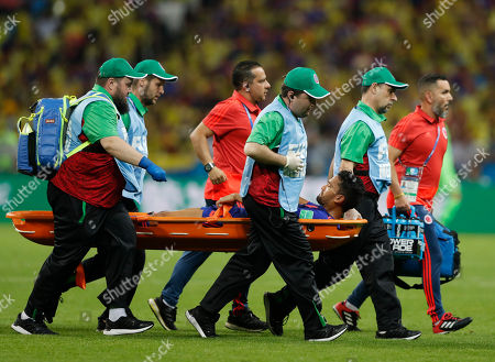 Colombia's Abel Aguilar is carried on a stretcher out of the pitch after being injured during the group H match between Poland and Colombia at the 2018 soccer World Cup at the Kazan Arena in Kazan, Russia