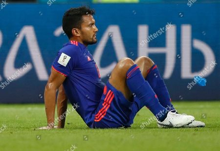 Colombia's Abel Aguilar sits on the pitch after being injured during the group H match between Poland and Colombia at the 2018 soccer World Cup at the Kazan Arena in Kazan, Russia