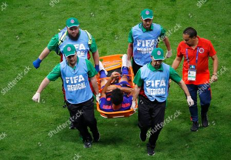 Abel Aguilar of Colombia is brought off the pitch on a stretcher during the during the FIFA World Cup 2018 group H preliminary round soccer match between Poland and Colombia in Kazan, Russia, 24 June 2018. (RESTRICTIONS APPLY: Editorial Use Only, not used in association with any commercial entity - Images must not be used in any form of alert service or push service of any kind including via mobile alert services, downloads to mobile devices or MMS messaging - Images must appear as still images and must not emulate match action video footage - No alteration is made to, and no text or image is superimposed over, any published image which: (a) intentionally obscures or removes a sponsor identification image; or (b) adds or overlays the commercial identification of any third party which is not officially associated with the FIFA World Cup)