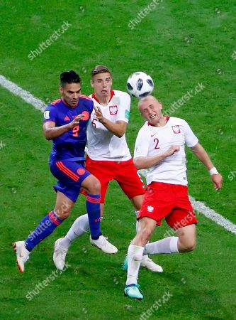 Michal Pazdan (R) of Poland clears the ball during the FIFA World Cup 2018 group H preliminary round soccer match between Poland and Colombia in Kazan, Russia, 24 June 2018. (RESTRICTIONS APPLY: Editorial Use Only, not used in association with any commercial entity - Images must not be used in any form of alert service or push service of any kind including via mobile alert services, downloads to mobile devices or MMS messaging - Images must appear as still images and must not emulate match action video footage - No alteration is made to, and no text or image is superimposed over, any published image which: (a) intentionally obscures or removes a sponsor identification image; or (b) adds or overlays the commercial identification of any third party which is not officially associated with the FIFA World Cup)