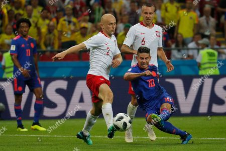 James Rodriguez of Colombia and Michal Pazdan of Poland