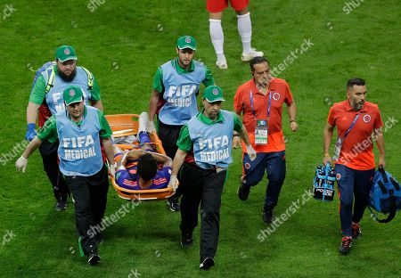 Stock Picture of Colombia's Abel Aguilar is carried off on a stretcher during the group H match between Poland and Colombia at the 2018 soccer World Cup at the Kazan Arena in Kazan, Russia