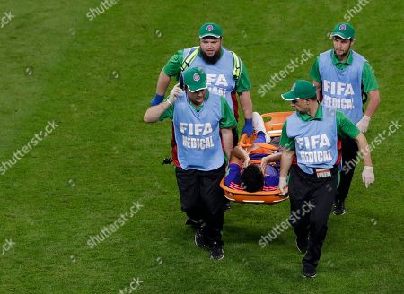 Stock Image of Colombia's Abel Aguilar is carried off on a stretcher during the group H match between Poland and Colombia at the 2018 soccer World Cup at the Kazan Arena in Kazan, Russia