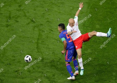 Poland's Michal Pazdan, right, and Colombia's Radamel Falcao collide during the group H match between Poland and Colombia at the 2018 soccer World Cup at the Kazan Arena in Kazan, Russia