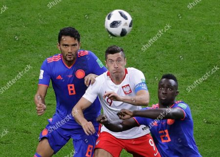 Stock Photo of Poland's Robert Lewandowski, center, battles with Colombia's Abel Aguilar, left, and Colombia's Davinson Sanchez during the group H match between Poland and Colombia at the 2018 soccer World Cup at the Kazan Arena in Kazan, Russia