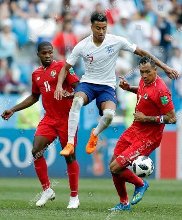 England's Jesse Lingard makes his way between Panama's Armando Cooper, left, and Panama's Blas Perez during the group G match between England and Panama at the 2018 soccer World Cup at the Nizhny Novgorod Stadium in Nizhny Novgorod, Russia