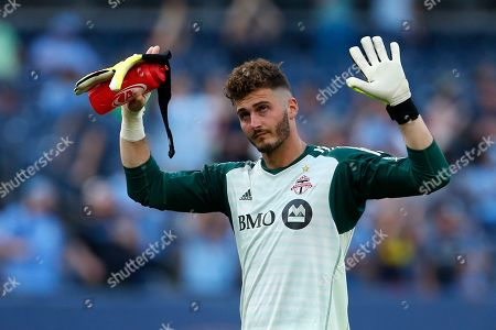 Toronto FC goalkeeper Alex Bono reacts to fans while walking off the field after losing to New York City FC in an MLS soccer game, in New York
