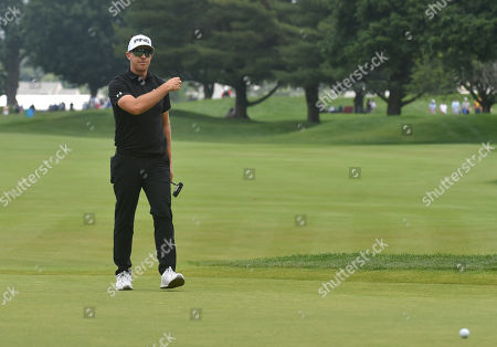 Hunter Mahan reacts after missing a putt on the 6th green during the final round of the Travelers Golf Championship at TPC River Highlands in Cromwell, Connecticut