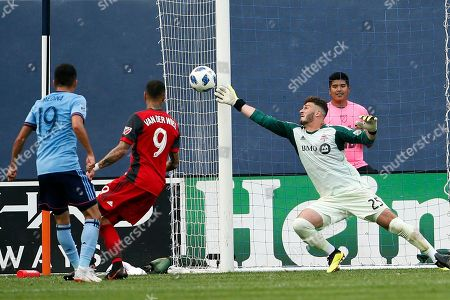 Toronto FC goalkeeper Alex Bono (25) makes a save on a shot by New York City FC forward Jesus Medina (19) during the second half of an MLS soccer game, in New York