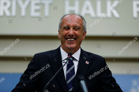 A day after elections, Muharrem Ince, the candidate of Turkey's main opposition Republican People's Party, laughs during a news conference in Ankara, Turkey, . Turkey's president Recep Tayyip Erdogan, 64 who has dominated Turkish politics for the past 15 years, is the winner of Sunday's polls and was set to extend his rule with sweeping new powers after winning landmark presidential and parliamentary elections