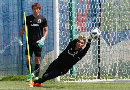 Japan's goalkeeper Kosuke Nakamura (R) and Masaaki Higashiguchi (L) during a training session at the FC Rubin Training Ground sports base in Kazan, Russian Federation, 25 June 2018. Japan will face Poland on 28 June in Volgograd for their last group match at the FIFA World Cup 2018.