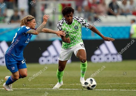 Nigeria's Alex Iwobi, right, duels for the ball with Iceland's Ari Skulason during the group D match between Nigeria and Iceland at the 2018 soccer World Cup in the Volgograd Arena in Volgograd, Russia