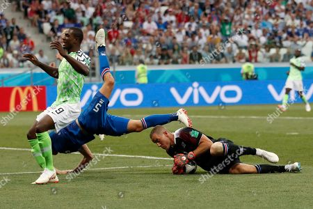 Iceland goalkeeper Hannes Halldorsson, right, makes a save in front of Nigeria's Odion Ighalo, left, during the group D match between Nigeria and Iceland at the 2018 soccer World Cup in the Volgograd Arena in Volgograd, Russia