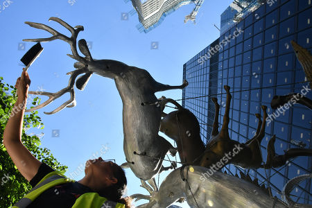 Stock Image of Nancy Rubins' 'Crocodylius Philodendrus', a large 3x4x3.5 metre arrangement comprised of animals cast in iron, bronze, brass and aluminium