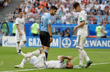 Russia's Fyodor Kudryashov reacts after a challenge during the group A match between Uruguay and Russia at the 2018 soccer World Cup at the Samara Arena in Samara, Russia