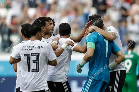 Egypt goalkeeper Essam El Hadary, right, is congratulated by his teammates after defending a penalty kick during the group A match between Saudi Arabia and Egypt at the 2018 soccer World Cup at the Volgograd Arena in Volgograd, Russia