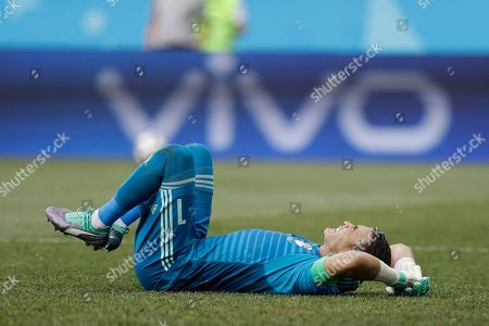 Egypt goalkeeper Essam El Hadary reacts in pain during the group A match between Saudi Arabia and Egypt at the 2018 soccer World Cup at the Volgograd Arena in Volgograd, Russia