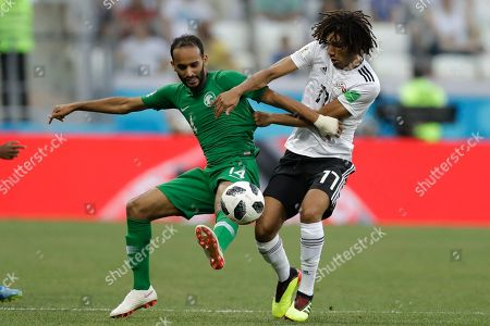 Egypt's Mohamed Elneny, right, and Saudi Arabia's Abdullah Otayf challenge for the ball during the group A match between Saudi Arabia and Egypt at the 2018 soccer World Cup at the Volgograd Arena in Volgograd, Russia