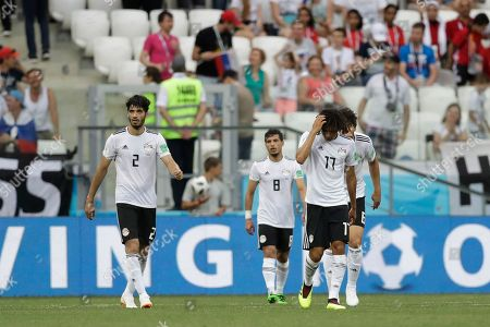 Egypt's Ali Gabr, left, Tarek Hamed, center, and Mohamed Elneny walk on the pitch at the end of the group A match between Saudi Arabia and Egypt at the 2018 soccer World Cup at the Volgograd Arena in Volgograd, Russia