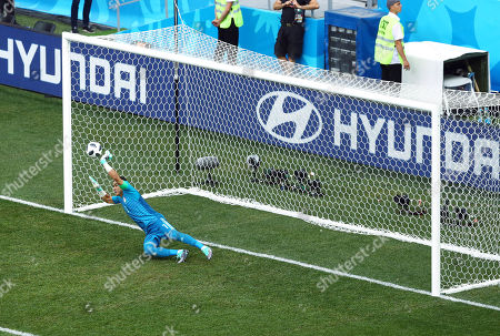 Egypt goalkeeper Essam El-Hadary saves a penalty kick from Fahad Al-Muwallad of Saudi Arabia