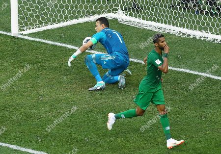Salman Al-Faraj of Saudi Arabia celebrates scoring a goal from the penalty spot to make it 1-1 in front of Egypt goalkeeper Essam El-Hadary