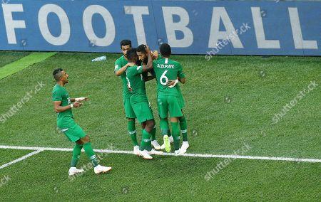 Stock Photo of Salman Al-Faraj of Saudi Arabia celebrates scoring a goal from the penalty spot to make it 1-1 with his team-mates