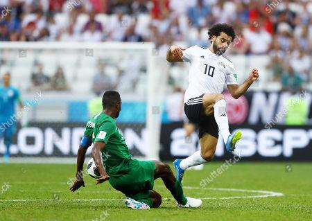 Mohamed Salah of Egypt and Osama Hawsawi of Saudi Arabia