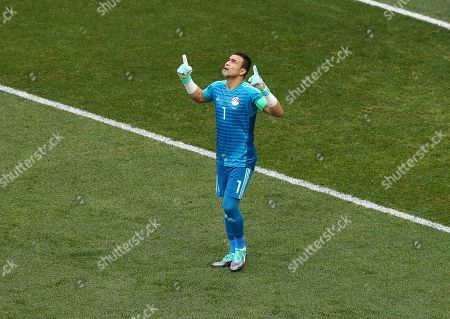 Egypt goalkeeper Essam El-Hadary prays ahead of the game as he becomes the oldest player to play at the World Cup