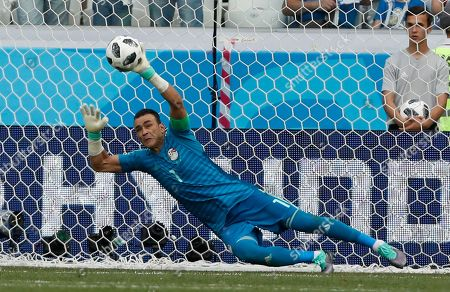 Egypt goalkeeper Essam El Hadary deflects a penalty during the group A match between Saudi Arabia and Egypt at the 2018 soccer World Cup at the Volgograd Arena in Volgograd, Russia