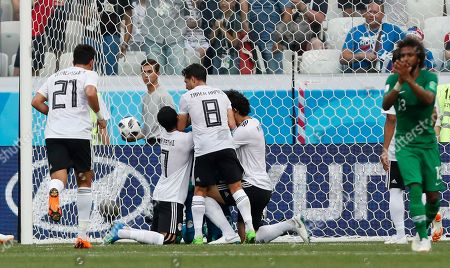 Egypt goalkeeper Essam El Hadary, hidden, is congratulated by his teammates after deflecting a penalty during the group A match between Saudi Arabia and Egypt at the 2018 soccer World Cup at the Volgograd Arena in Volgograd, Russia