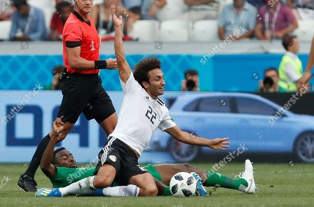 Saudi Arabia's Osama Hawsawi, left, and Egypt's Amr Warda challenge for the ball during the group A match between Saudi Arabia and Egypt at the 2018 soccer World Cup at the Volgograd Arena in Volgograd, Russia