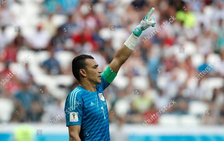 Egypt goalkeeper Essam El Hadary directs his teammates during the group A match between Saudi Arabia and Egypt at the 2018 soccer World Cup at the Volgograd Arena in Volgograd, Russia