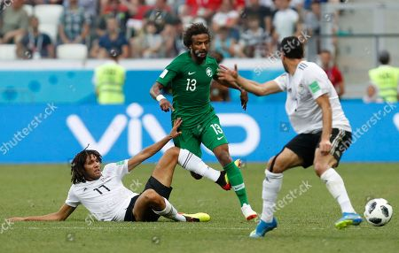 Saudi Arabia's Yasir Alshahrani goes past Egypt's Kahraba, left, during the group A match between Saudi Arabia and Egypt at the 2018 soccer World Cup at the Volgograd Arena in Volgograd, Russia