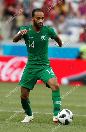 Saudi Arabia's Abdullah Otayf goes with the ball during the group A match between Saudi Arabia and Egypt at the 2018 soccer World Cup at the Volgograd Arena in Volgograd, Russia