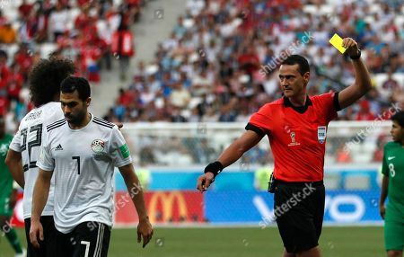 Egypt's Ahmed Fathi, left, is booked by referee Wilmar Roldan from Colombia during the group A match between Saudi Arabia and Egypt at the 2018 soccer World Cup at the Volgograd Arena in Volgograd, Russia